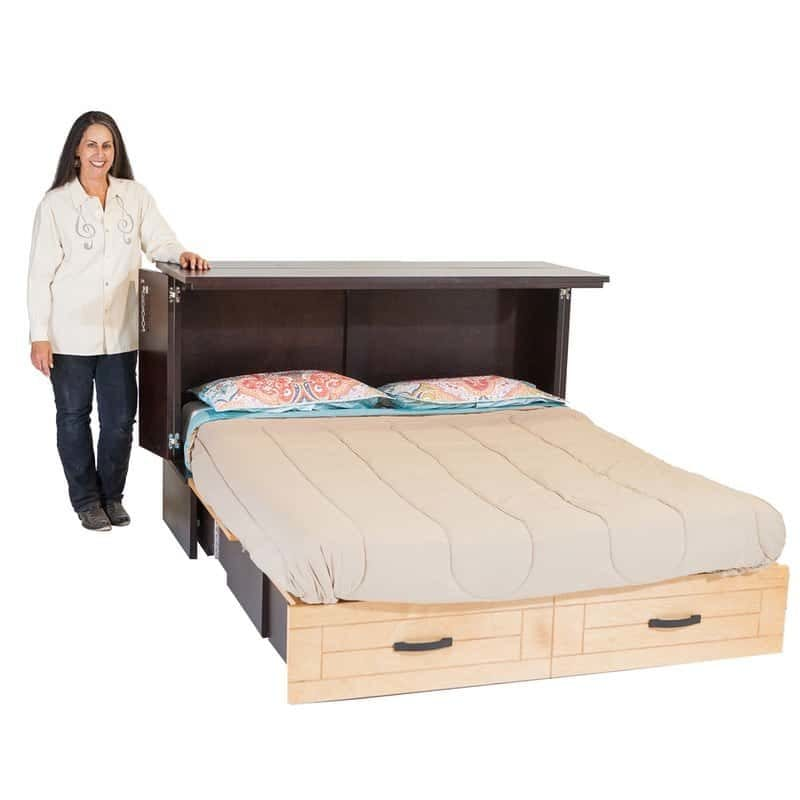 CBUSA owner Harriet Greenlee and a Metro Cabinet Bed espresso natural finishes